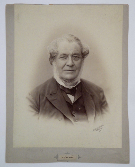 Very large photograph by Edward Schultze, Heidelberg, with autograph signature of Bunsen mounted below. Robert Bunsen.